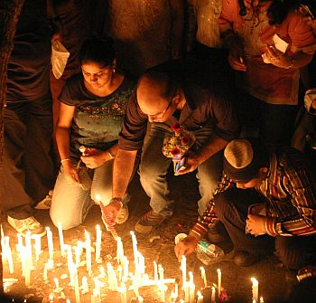 People light candles to pay their respects to those who lost their lives during the attacks.