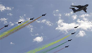 Planes from the Chinese People's Liberation Army air force fly in formation during the parade