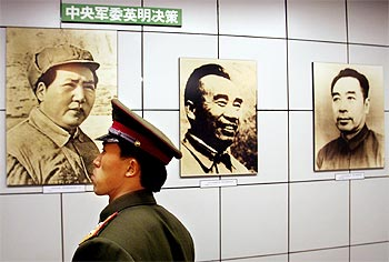 A Chinese police officer at an exhibition to mark the 50th anniversary of the liberation of Beijing.