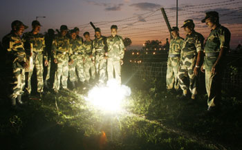 BSF soldiers set off fire crackers to celebrate Diwali at the India-Bangladesh border on the outskirts of Siliguri