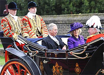 Prince Charles and Camilla, Duchess of Cornwall, ride in a carriage after the official greeting of President Patil by Queen Elizabeth