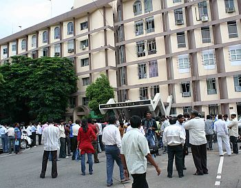 Media persons wait outside the secretariat, awaiting information on the CM