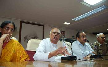 Finance Minister K Rosiah addresses media persons along with Chief Secretary Ramakanth Reddy