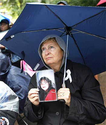 Marta Waisman holds a photo of her daughter Gabriela, who lost her life in the World Trade Centre attack