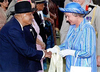 Queen Elizabeth II greets Ganju Lama, an Indian winner of the Victoria Cross, in Delhi