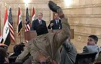 Zeidi throwing his shoes at Mr Bush in 2008