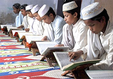 Muslim children read the Quran at a madrassa