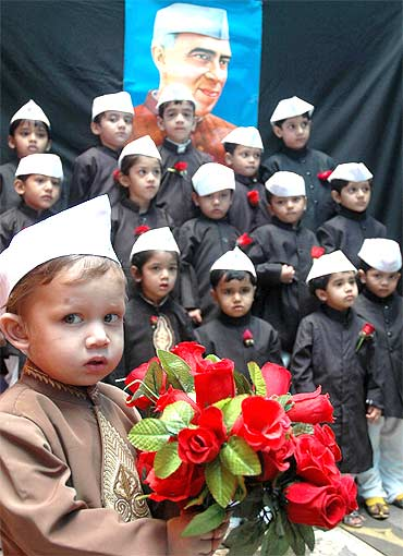 School children dressed as Chacha Nehru take part in a fancy dress competition