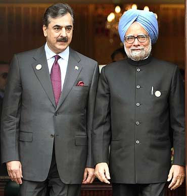 A file photo of Dr Singh and Pakistan PM Gilani