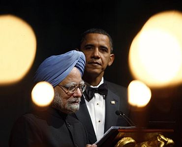File photo of Prime Minister Manmohan Singh taken during his visit to Washington. In the background, President Obama listens on
