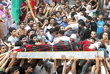 Men carry the body of Mohammad Iqbal, a Kashmiri youth killed during the protests
