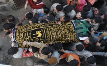People carry the body of Khursheed Ahmad Parray, who was killed during an attack by militants in Khan Sahib, Kashmir