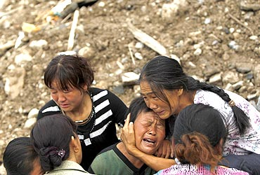 People mourn their missing relatives in the landslide-hit Zhouqu county of Gannan, China