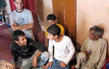 Children assemble in a Srinagar home before heading out to protest