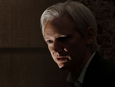 Assange speaks at a news conference at the Frontline Club in central London