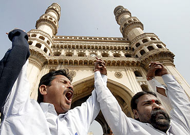Telangana supporters demonstrate in front of Hyderabad's Charminar