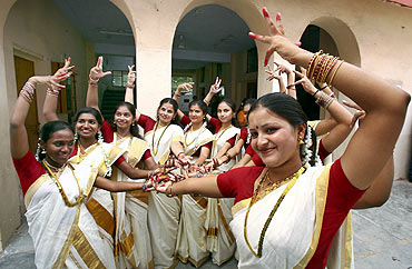Traditionally dressed women dancers perform during the Onam festivities