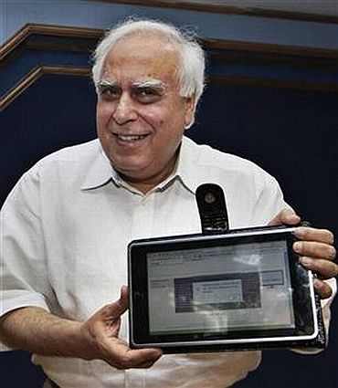 Human Resource Development Minister Kapil Sibal shows off India's first low cost tablet PC