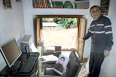 Mohammed Ashraf Mattoo in his son Tufail's study room