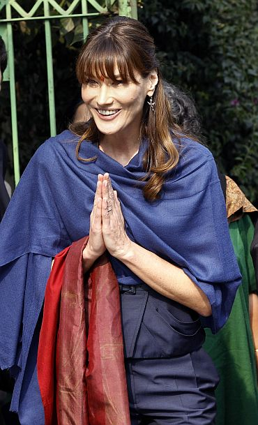 Carla Bruni-Sarkozy waves local residents and journalists as she leaves Naz Foundation care home for orphaned children with HIV-AIDS in New Delhi
