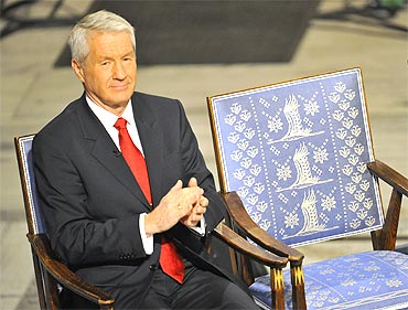 Norwegian Nobel Committee chairman Thorbjorn Jagland applauds next to the empty chair