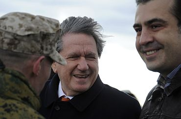 Holbrooke and Georgia's President Saakashvili watch ongoing war games outside Tbilisi
