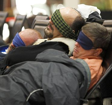 Travellers sleep at the main terminal of Frankfurt's airport