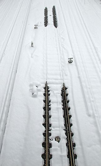 Snow covers rail tracks on the line to Gatwick Airport, in southern England