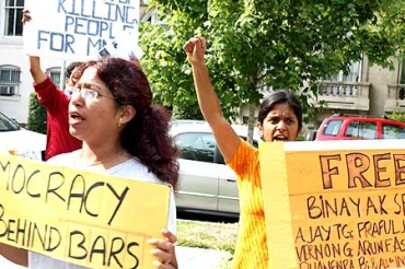 Protesters hold placards during a protest demanding the release of Dr Binayak Sen