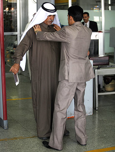A security officer checks a passenger at the departure lounge of Sanaa International Airport in Yemen