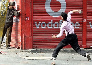 A Kashmiri protester hurls a stone at a policeman during a protest in Srinagar in 2011. Photograph: Danish Ismail/Reuters