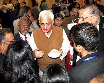 Corporate Affairs Minister Salman Khursheed peaking to some disgruntled overseas Indians at the sidelines of the ceremony on Thursday