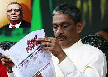 Presidential candidate Sarath Fonseka reads an article in the opposition JVP (People's Liberation Front) party's newspaper. (Inset) Razik Zarook