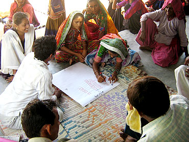Women draw layouts to rebuild their houses in Kutch