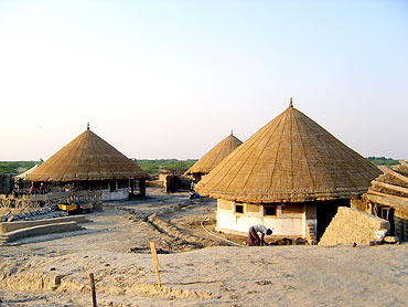 Houses rebuilt by villagers in Kutch