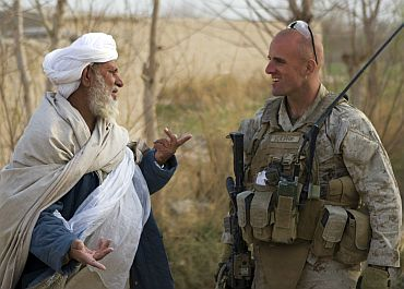 US Marine Corps Capt Scott A Cuomo, commander of Fox Company, Second Battalion, Second Marine Regiment, speaks with an Afghan villager in Garmsir district, Helmand province, Afghanistan