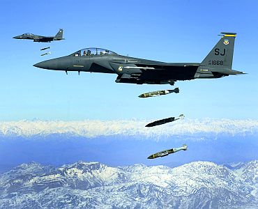 US Air Force F-15E Strike Eagle aircraft from the 335th Fighter Squadron drop 2,000-pound joint direct attack munitions on a cave in eastern Afghanistan