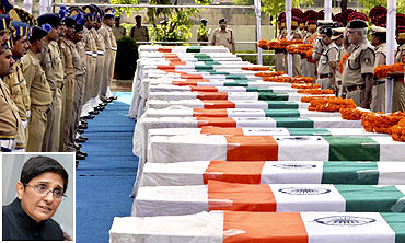 CRPF personnel pay tribute to policemen who died in a Maoist attack in Dantewada. Inset: Kiran Bedi