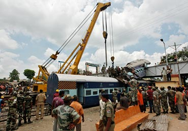 Army personnel help at the mishap site