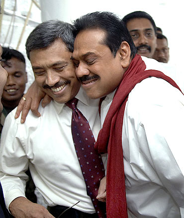 Sri Lankan President Mahinda Rajapakse, right, hugs his brother Gothabaya. Photograph: Sudath Silva/Reuters