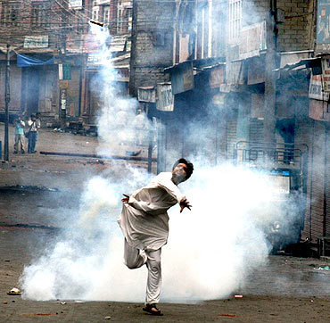 A protestor throws a crude bomb towards security forces in Srinagar
