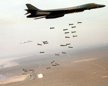 A US Air Force bomber drops cluster bombs during a training exercise