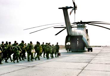 Russian soldiers board a Mi-26 helicopter near Grozny