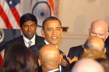 Obama interacts with Indian American delegates