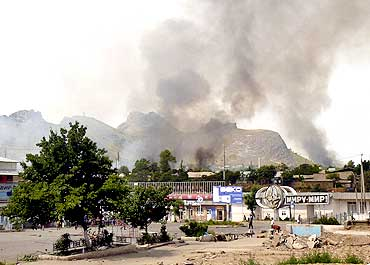 Smoke rises from the residential area of the city of Osh in Kyrgyzstan