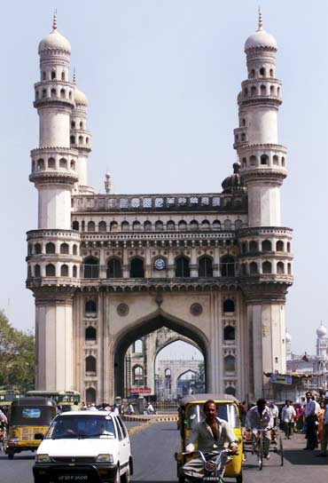 Residents of Hyderabad drive past Charminar