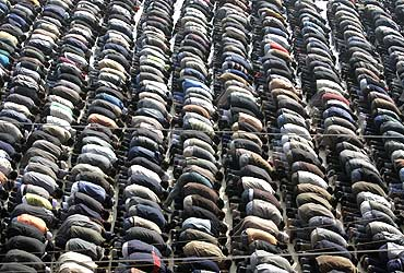 Muslim men perform special prayers outside a mosque
