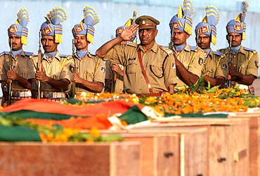 CRPF men pay their last respects to fallen colleagues massacred by Maoists in Dantewada.