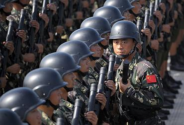 Soldiers from Chinese People's Liberation Army  special force take part in a parade