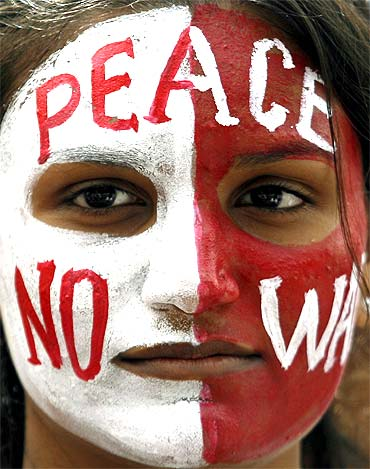 A student with a peace message painted on her face attends an anti-nuclear demonstration rally